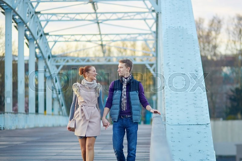 Stock image of 'Romantic couple in Paris walking together'