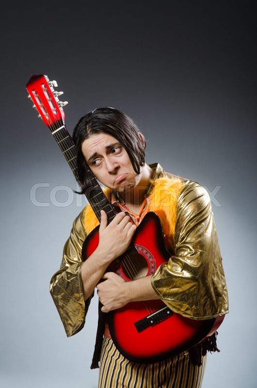 Stock image of 'Man with guitar in musical concept'