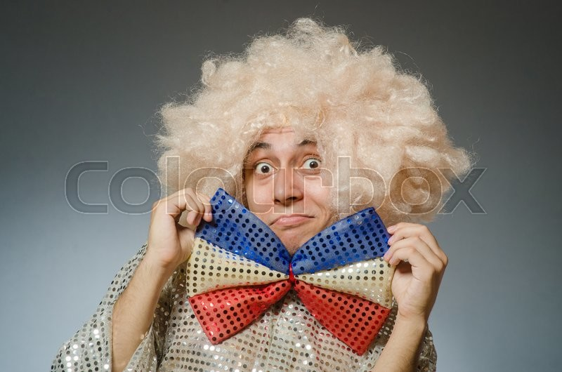Stock image of 'Funny man with afro wig'