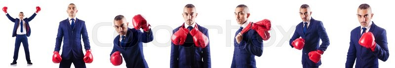 Stock image of 'Handsome businessman with boxing gloves'