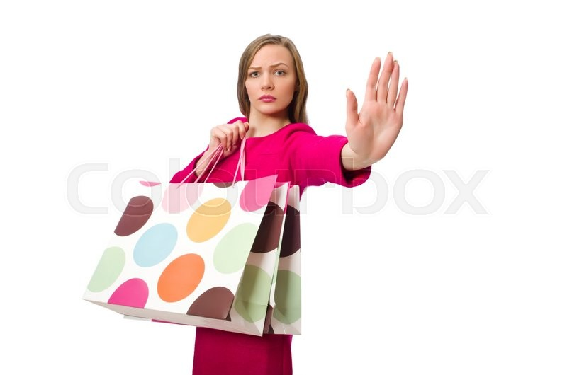 Stock image of 'Shopper girl in pink dress holding plastic bags isolated on white'