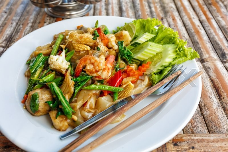 Stock image of 'Fried vegetables and seafood in sauce in Thailand'