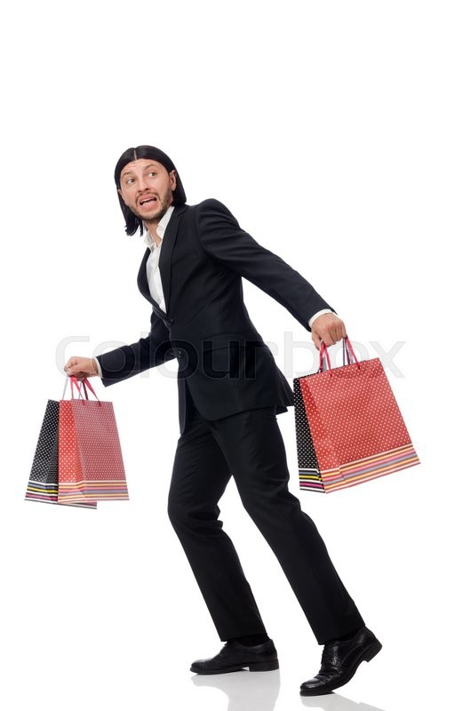 Stock image of 'Black suit man holding plastic bags isolated on white'