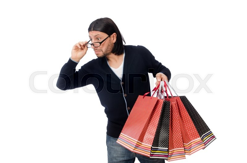 Stock image of 'Young man holding plastic bags isolated on white'