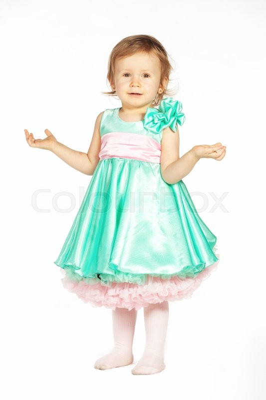 Stock image of 'Little girl in a green dress isolated on white '