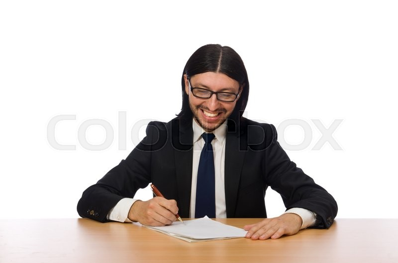 Stock image of 'Businessman writing at workplace isolated on white'