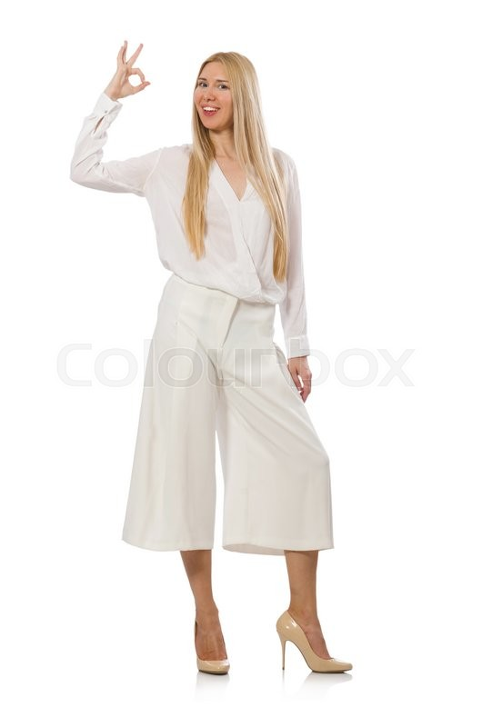 Stock image of 'Blond hair model in elegant flared pants isolated on white'