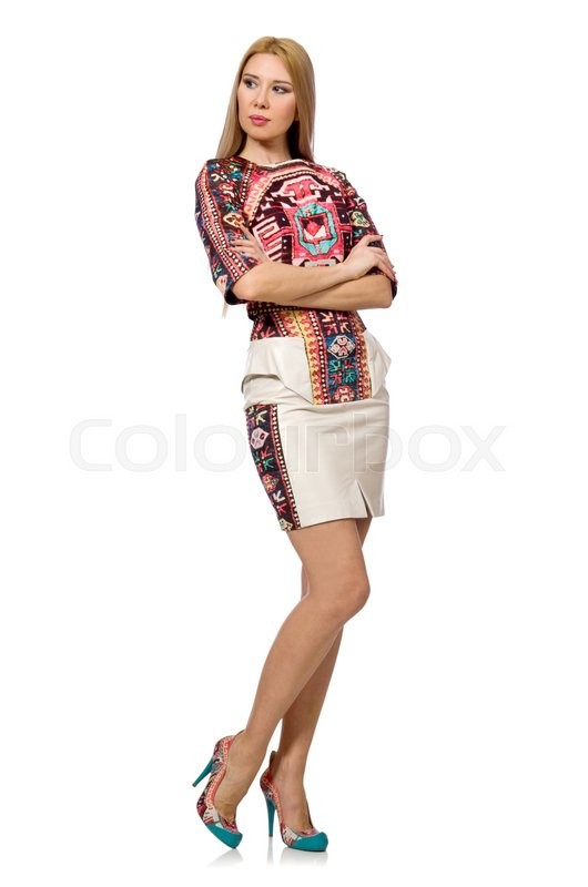 Stock image of 'Pretty model in clothes with carpet prints isolated on white'