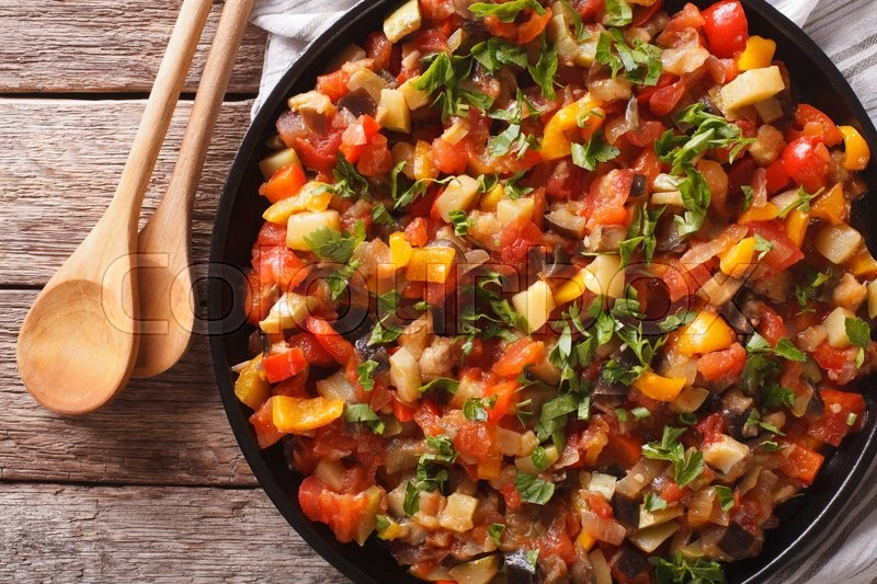 Stock image of 'Spanish cuisine: vegetable stew Pisto manchego close-up on a plate on the table. Horizontal view from above\'