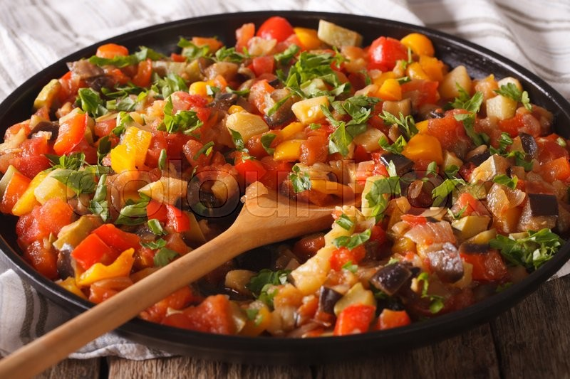 Stock image of 'Spanish cuisine: vegetable stew Pisto manchego macro on a plate on the table. Horizontal '