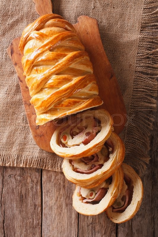 Stock image of 'Venezuelan Christmas Pan de jamon close-up on the table. vertical view from above\'