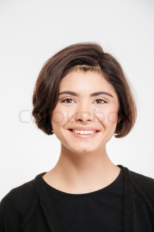 Stock image of 'Smiling casual woman looking at camera isolated on a white background'