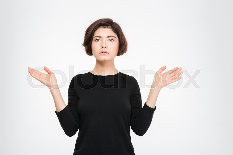 Stock image of 'Pensive woman standing isolated on a white background'