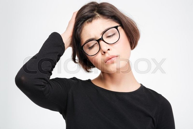 Stock image of 'Sad woman standing isolated on a white background'