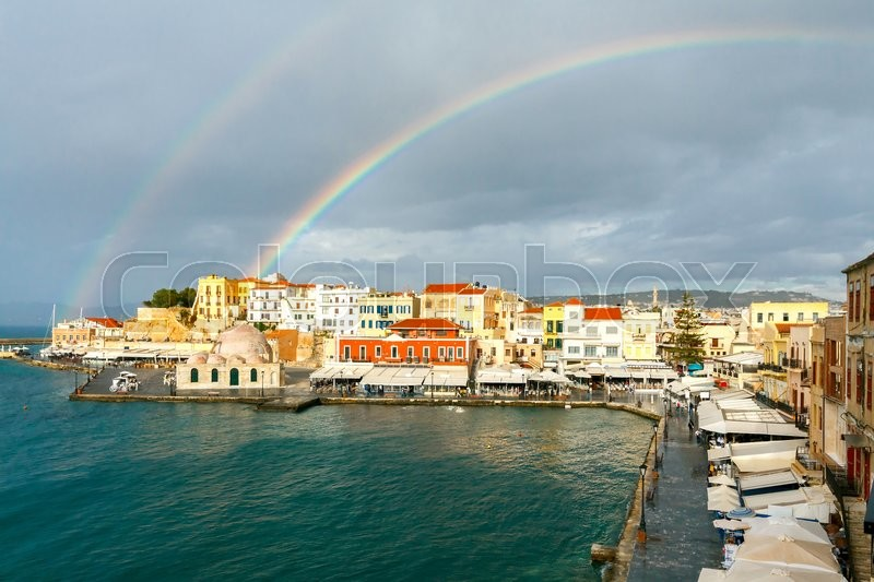 Stock image of 'Scenic view of a rainbow after the rain of the Venetian waterfront of Chania. Mosque Hassan Kuchuk Pasha. Crete, Greece.'