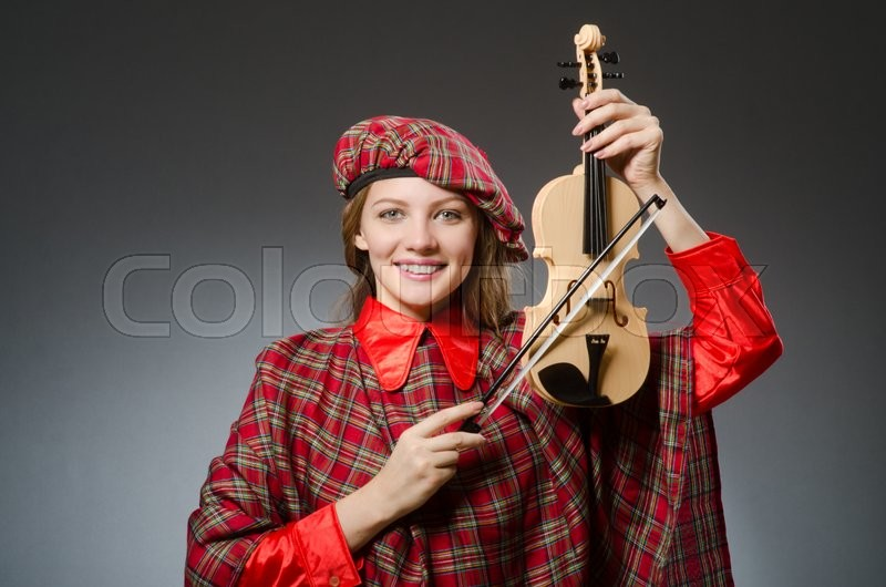 Stock image of 'Woman in scottish clothing in musical concept'