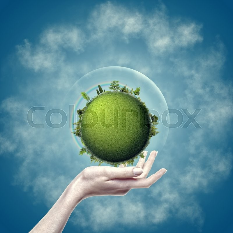 Stock image of 'Green Earth into female hand against blue backgrounds, eco design'