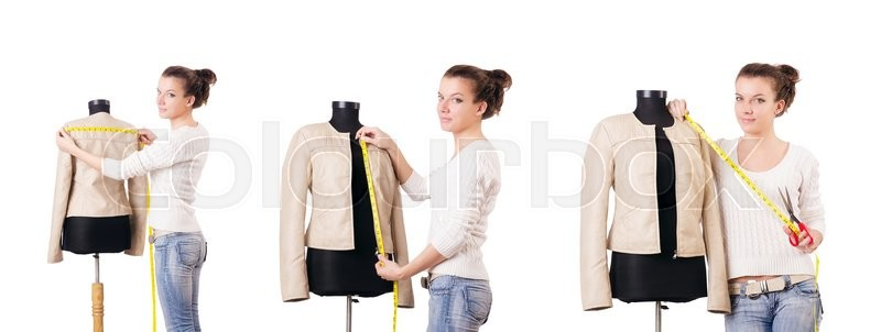 Stock image of 'Woman tailor working on dress'