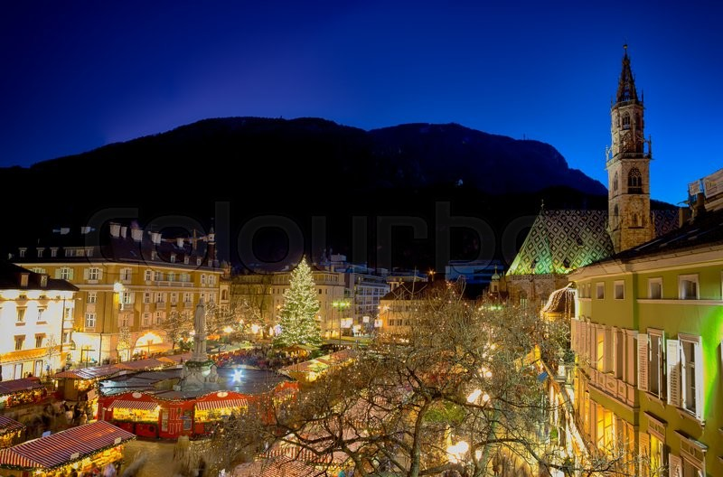 Stock image of 'Christmas market in Bolzano with lights and decorations in Walther Square'