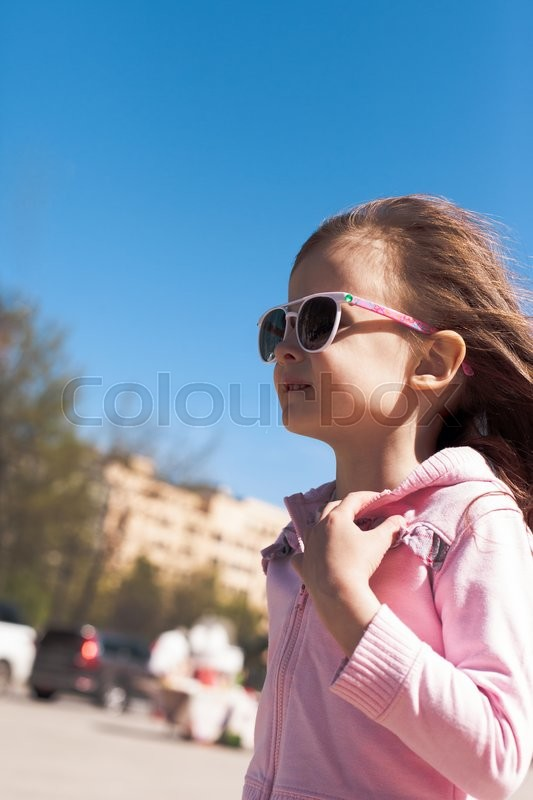 Stock image of 'Portrait of beautiful baby girl walking on the street'