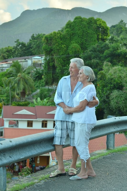Stock image of 'Beautiful happy elderly couple rest at tropical resort'