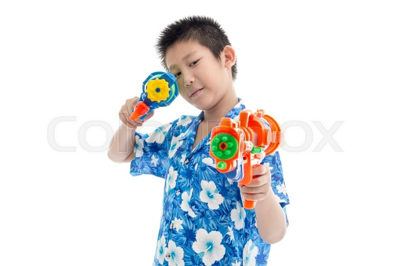 Stock image of 'Young Asian boy with water gun'