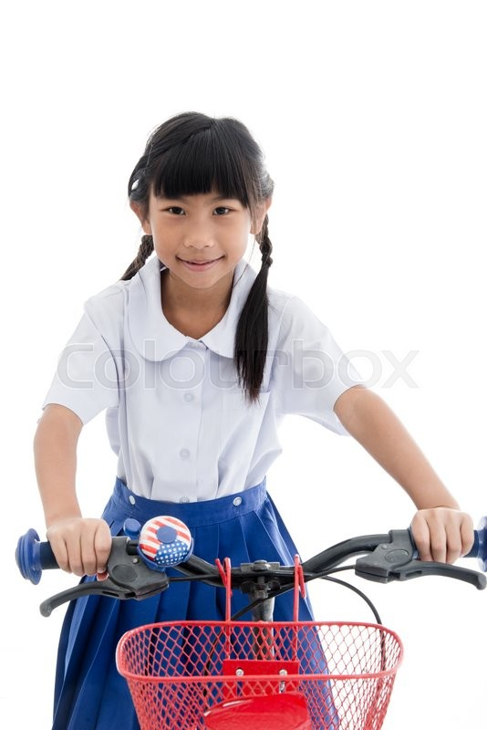 Stock image of 'Asian kids cute girl in student's uniform riding bicycle to school on white.'