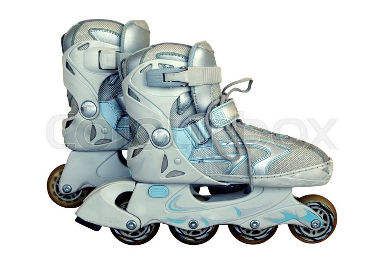 Stock image of 'Old worn roller skates on a wall background'