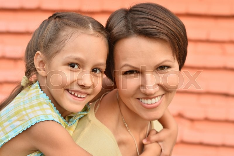 Stock image of 'Little cute girl with mother in park'