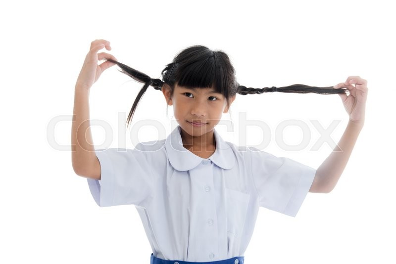 Stock image of 'Asian child in uniform with pigtail on white background.'