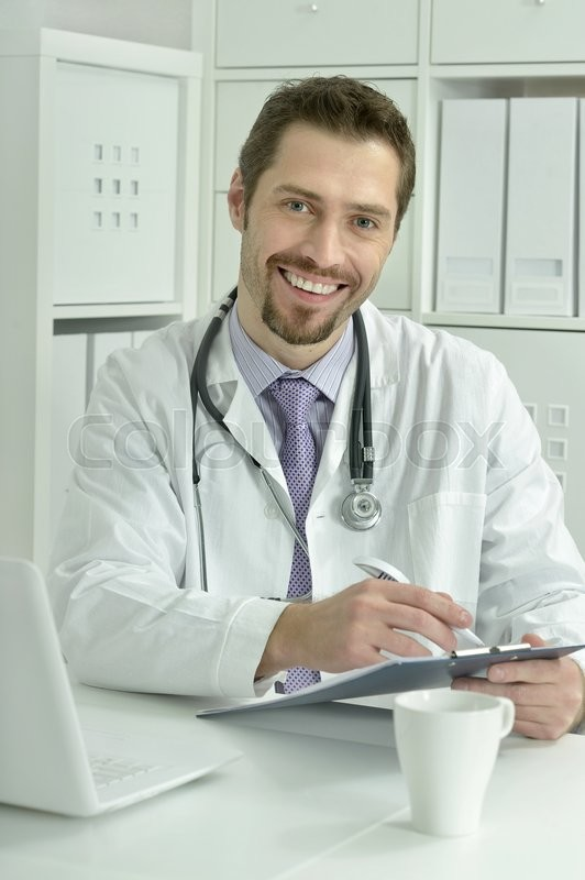 Stock image of 'Portrait of a young doctor with laptop'