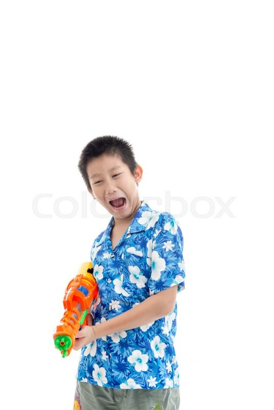 Stock image of 'Young Asian boy with water gun with copyspace on white'