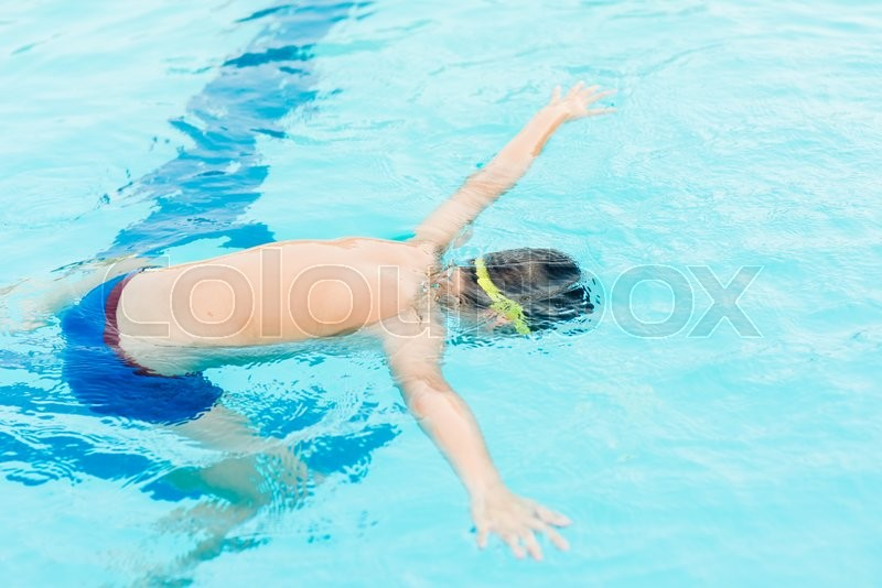 Stock image of 'Swimming boy under water in pool'