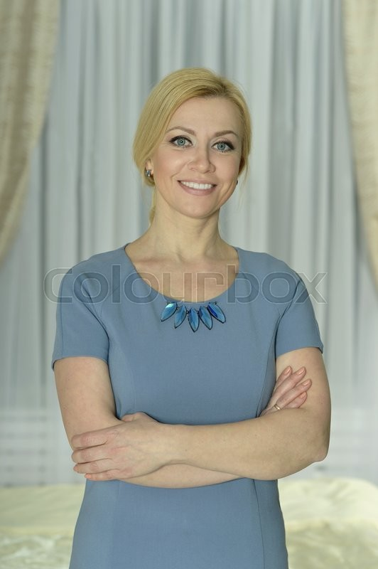 Stock image of 'Portrait of a  beautiful woman  at home'