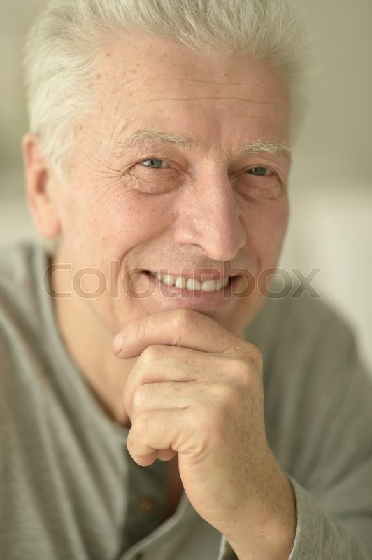 Stock image of 'Portrait of a happy senior man close up'