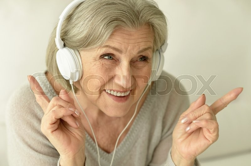 Stock image of 'Portrait of a senior woman with headphones'