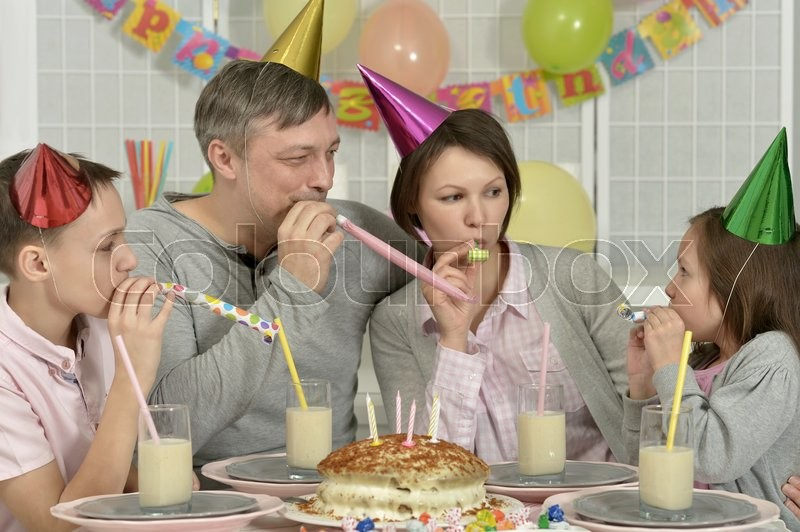 Stock image of 'Portrait of a happy family celebrating birthday at home'
