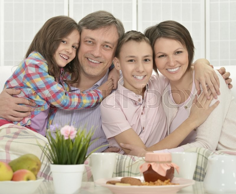 Stock image of 'Portrait of a happy family  in room'