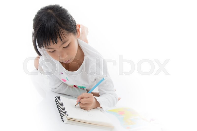 Stock image of 'Little Asian artist child drawing on white background'