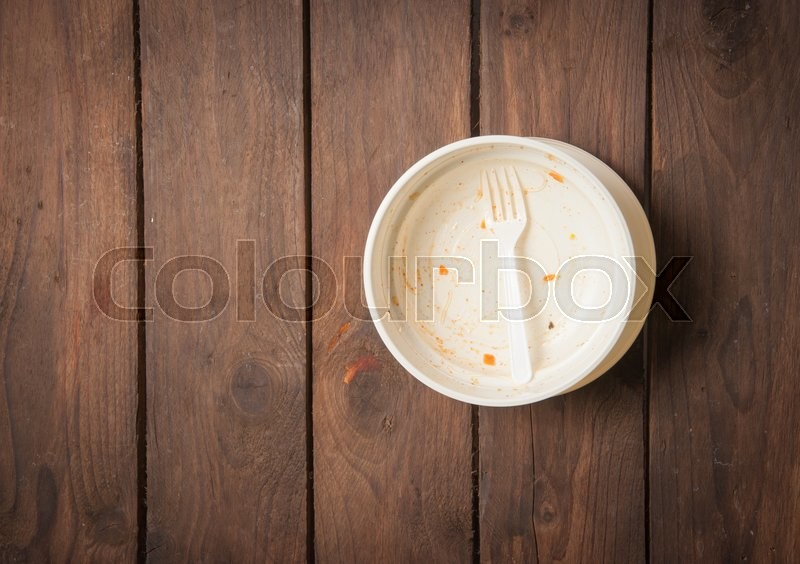 Stock image of 'Empty dish after food on white wood,top view'