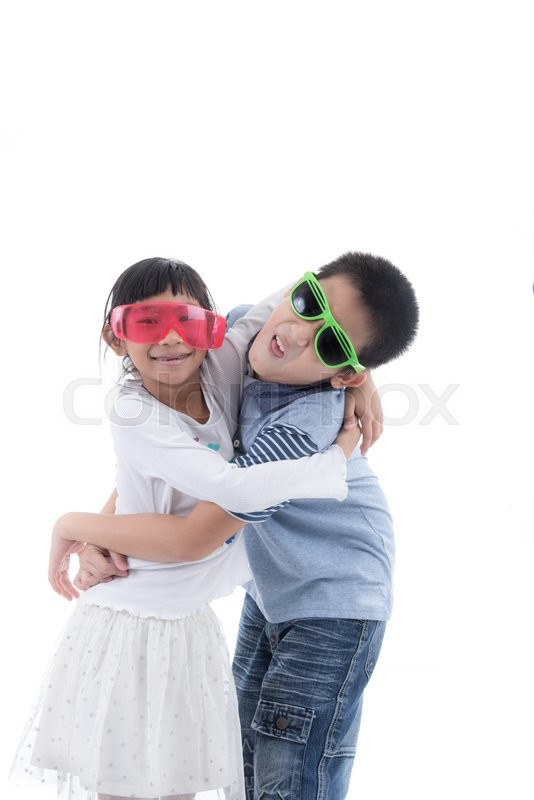 Stock image of 'Pretty girl hugging Asian boy isolated on white'