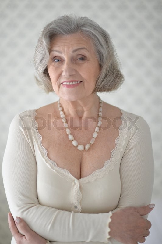 Stock image of 'Portrait of a happy senior woman close up'