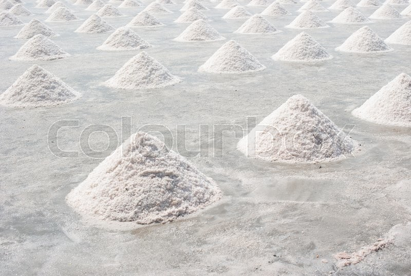 Stock image of 'Salt fields with piled up sea salt in Thailand'