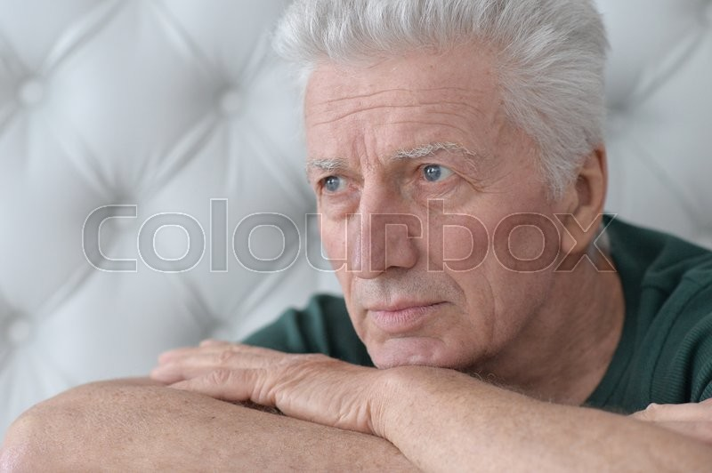 Stock image of 'Portrait of a sad senior man face'