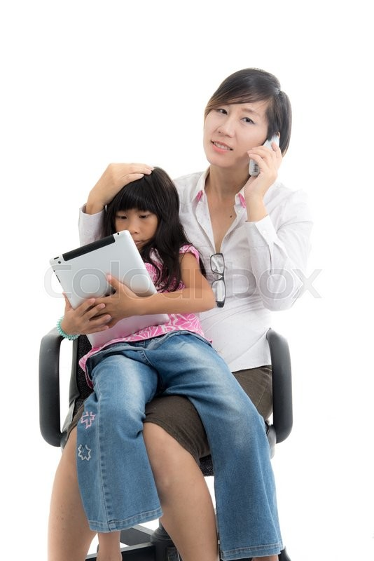Stock image of 'Working mother and daughter with tablet are sitting on office chair'