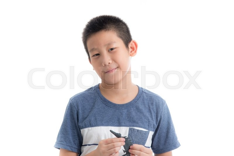 Stock image of 'Asian boy playing clay on white background'