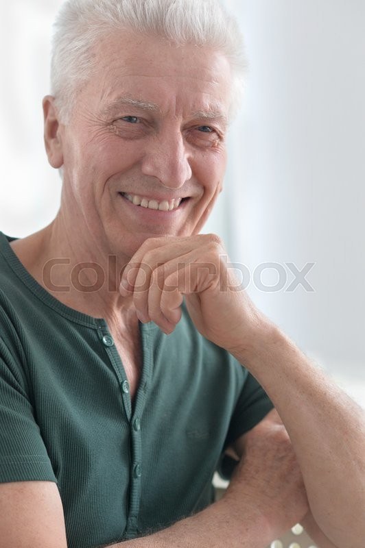 Stock image of 'Portrait of a happy senior man face'