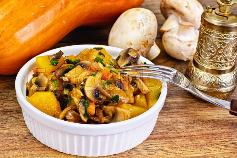 Stock image of 'Baked Pumpkin with Mushrooms and Vegetables. Vegetarian Food. Studio Photo'
