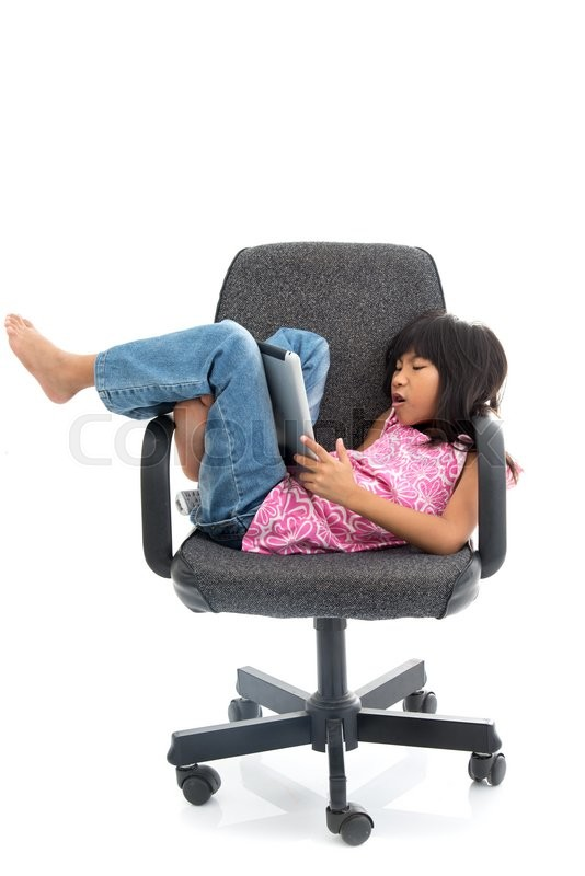 Stock image of 'Cute girl  sitting on a chair using Digital Tablet'
