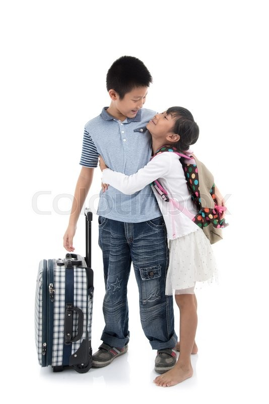 Stock image of 'Happy Asian children hoding together with suitcase on white background, traveller concept'